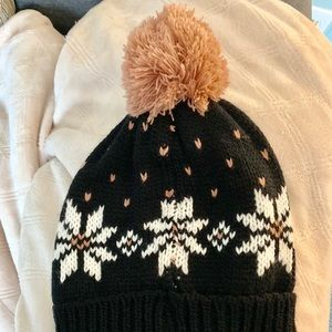 Black puffball hat